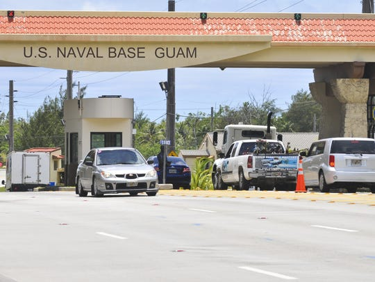 Traffic passes through the gates of Naval Base Guam