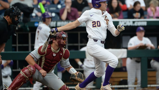 Jun 17, 2017; Omaha, NE, USA; LSU Tigers outfielder Antoine Duplantis (20) drives in a run in the third inning against the Florida State Seminoles at TD Ameritrade Park Omaha. Mandatory Credit: Steven Branscombe-USA TODAY Sports
