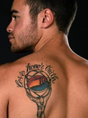Drew Di Lilloo poses for a portrait with a tattoo that he shares with his mother, Katie Coombs.