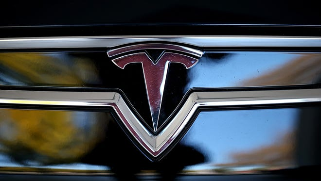 Tesla logo is shown on the front of a new Tesla Model S car at a Tesla showroom on November 5, 2013 in Palo Alto, California.
