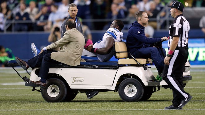Tyrunn Walker of the Detroit Lions is carted off the field after suffering an injury against the Seattle Seahawks on Oct. 5, 2015, in Seattle.
