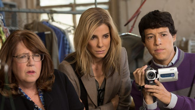 "This photo provided by Warner Bros. Pictures shows, Ann Dowd, from left, as Nell, Sandra Bullock as Jane and Reynaldo Pacheco as Eddie, in Warner Bros. Pictures and Participant Media's satirical comedy ""Our Brand Is Crisis,"" a Warner Bros. Pictures release. The movie opens in U.S. theaters on Oct. 30."