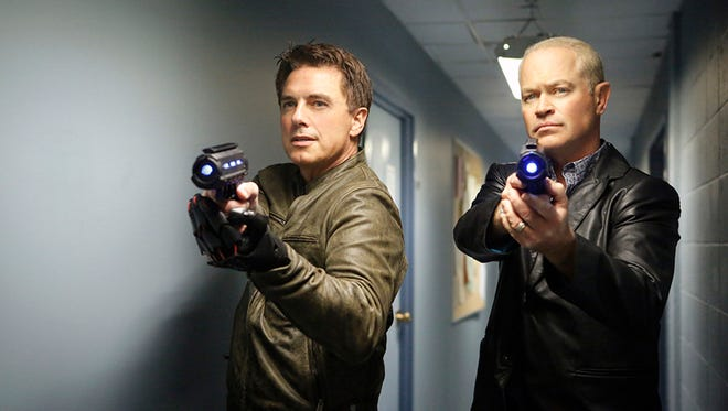 """Malcolm Merlyn (John Barrowman, left) and Damien Darhk (Neal McDonough) are two of the four members of the Legion of Doom on """"DC's Legends of Tomorrow."""""""