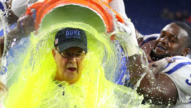 Duke head coach David Cutcliffe reacts to his Gatorade bath after the victory in last year's Quick Lane Bowl.