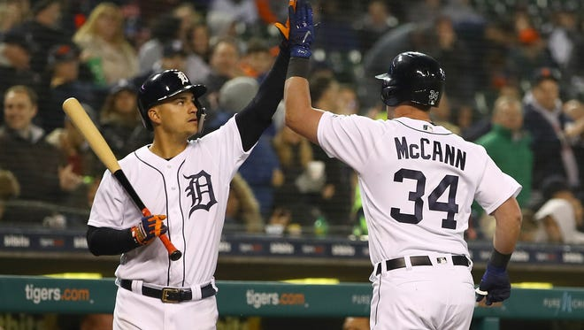 James McCann celebrates a fifth-inning home run with Jose Iglesias against the Yankees.