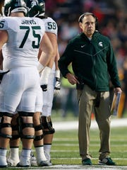 Nov 25, 2017; Piscataway, NJ, USA; Michigan State coach Mark Dantonio during a first half timeout against Rutgers at High Point Solutions Stadium.