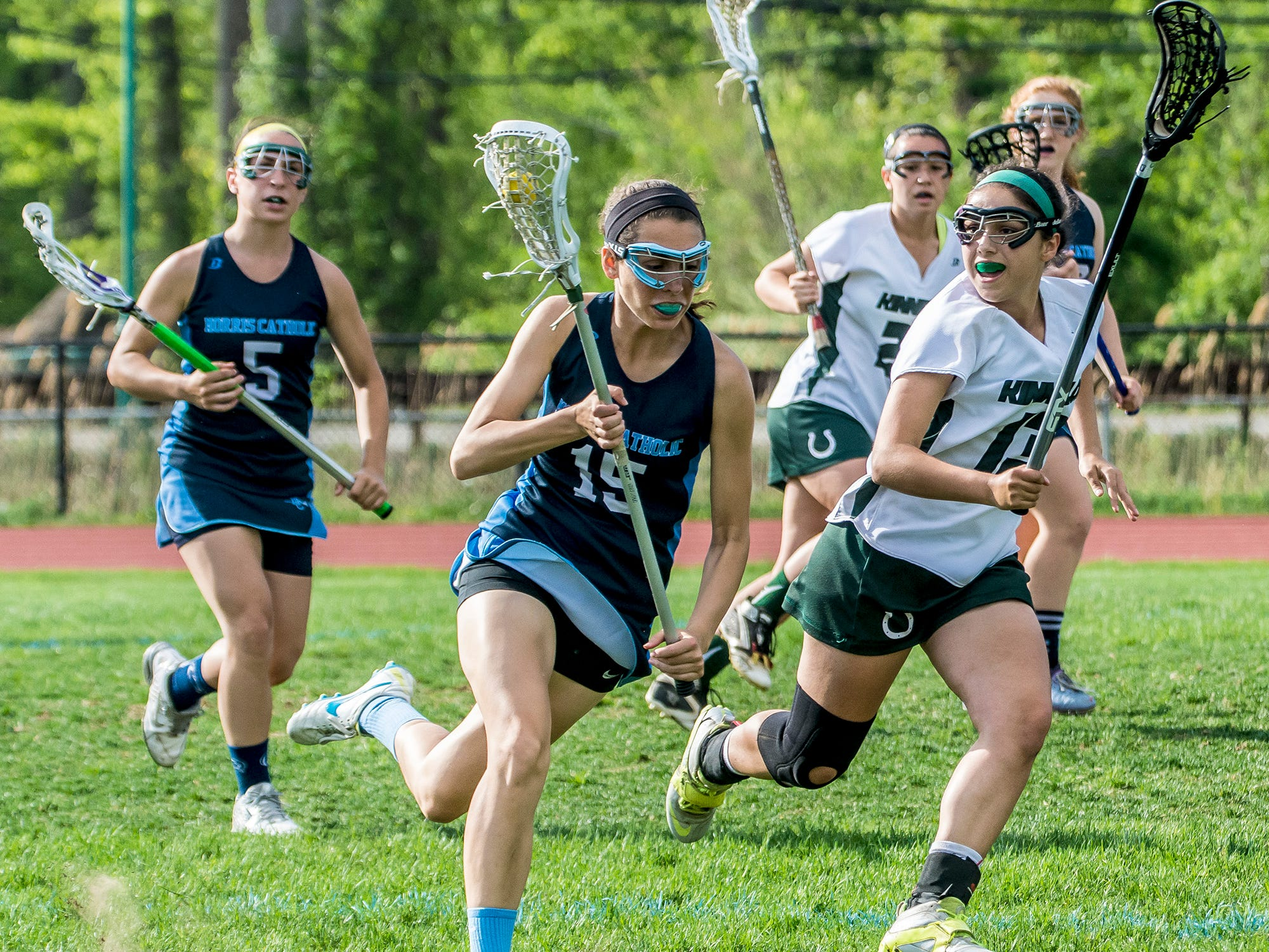 Morris Catholic's Kate Feeney (15) races downfield with the ball while chased by Kinnelon's Katie Bonnano (13) on Monday. Morris Catholic will face No. 1 Oak Knoll in the North Group I Tournament quarterfinals on Monday.