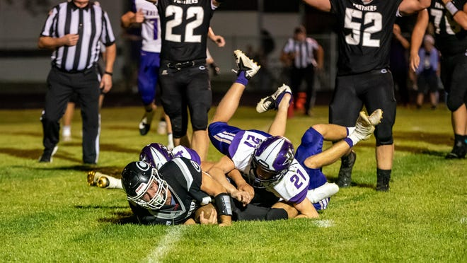 Centralia celebrates a touchdown Friday night during its 34-28 win over Hallsville.