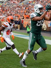 New York Jets tight end Austin Seferian-Jenkins (88) scores a two-yard touchdown as Cleveland Browns strong safety Ibraheim Campbell (24) defends during the second half of an NFL football game, Sunday, Oct. 8, 2017, in Cleveland. (AP Photo/Ron Schwane)