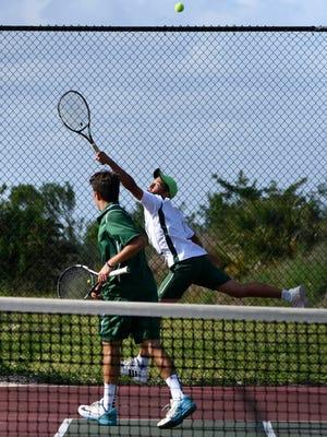 Gabe Diaz and Nico Fuchs play doubles during a regional match against Dwyer.