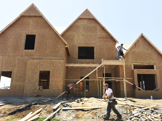 Workers build a home in the Boykin Lakes neighborhood in Pike Road.