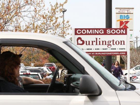 Drivers pass a sign along Clemson Boulevard on Wednesday advertising a Burlington store coming to Anderson.