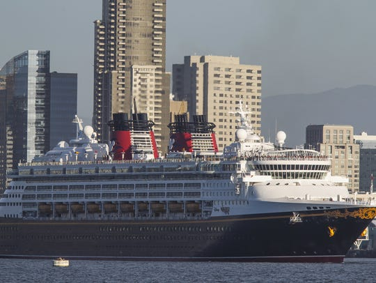 With the San Diego skyline behind it, the Disney Cruise