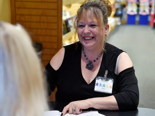 "In this photo from 2017, Cheryl Peterson, who offers a mentoring program for incarcerated women in York County Prison called Connect 2 Care, speaks with Victoria Lau. ""She's doing extremely well,"" Peterson said of Lau. ""I'm very, very proud of her progress."""