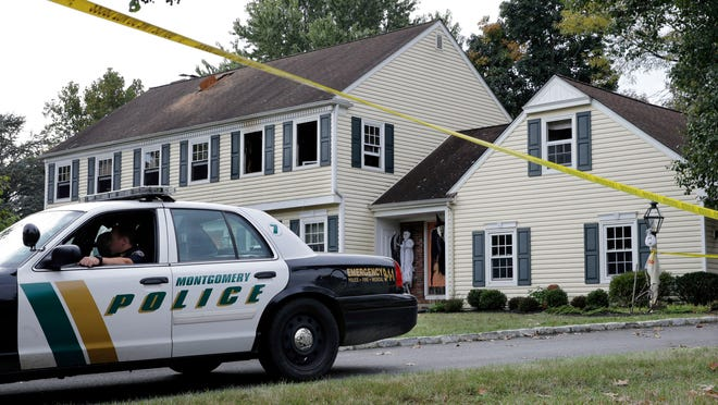 """AP A Montgomery Township police officer sits in front of the Sheridan's partially burned home on Meadow Run Drive early on Sept. 29. The fire remains under investigation. A Montgomery Township police officer sits in front of a partially burned home on Meadow Run Drive early Monday, Sept. 29, 2014, in Montgomery Township, N.J. John Sheridan, 72, the president of a major southern New Jersey hospital, and his 69-year-old wife, Joyce were killed when a fire broke out in their home, authorities said Sunday. The fire was contained to an upstairs bedroom, where they found the unresponsive couple. However, the """"circumstances surrounding the deaths"""" of Sheridan and his wife remain under investigation, Somerset County Prosecutor Geoffrey Soriano said. Authorities also have not said what sparked the fire early Sunday. (AP Photo/Mel Evans)"""