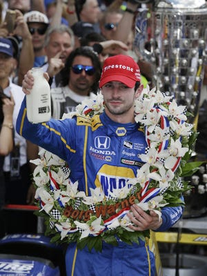 Alexander Rossi celebrates winning the 100th running of the Indianapolis 500, Sunday May 29, 2016.