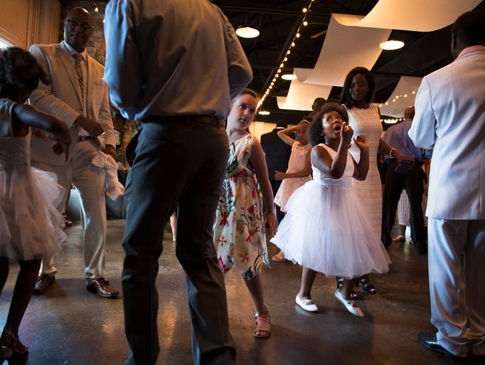 Harmonei Jenkins, 8, dances during a daddy daughter