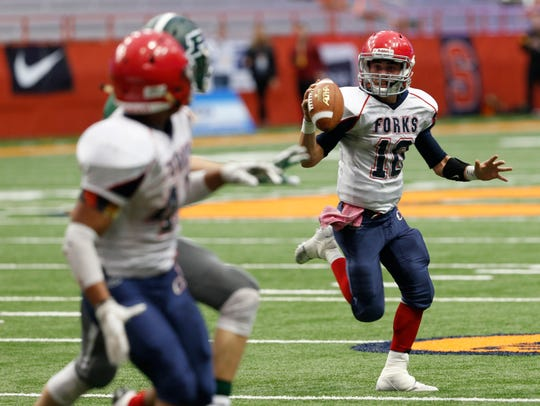 Chenango Forks quarterback Kris Borelli looks to pass against Pleasantville in Sunday's Class B title game at the Carrier Dome. The Blue Devils lost, 28-14.
