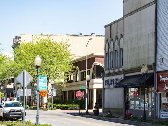 Storefronts in the 600 block of East Main Street, including