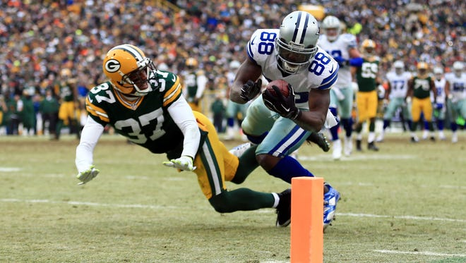 Cowboys WR Dez Bryant failed to haul in this pass in Dallas' narrow playoff loss to the Packers two years ago.