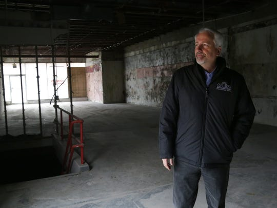 Renaissance Theatre President and CEO Mike Miller walks through a building at 168 Park Avenue. The 15,000-square-foot building was bought for $89 from the Richland County Land Bank and will be renovated into usable space for the theatre.