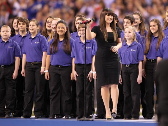 The Indianapolis Children's Choir backed up pop star Kelly Clarkson as she sang the national anthem prior to Super Bowl XLVI on Feb. 5, 2012, at Lucas Oil Stadium.