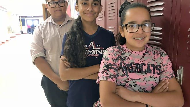 From left, Miguel Aguirre, 12, Brizella Baeza, 11, and Kristen Garcia, 12, are some of the sixth-grade students who will be the final class at Deming Intermediate School, built in 1942.