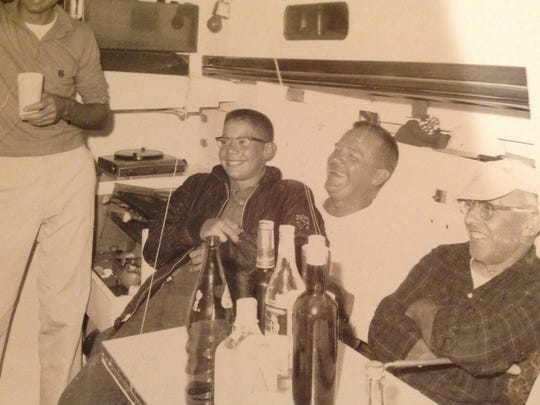 Rich Marsh, left, as a young boy sailed with his father, Marv, middle, and Lee Smith aboard Albacore in the Bell's Beer Bayview Mackinac race.