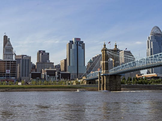 A view of Downtown Cincinnati from the banks of the Ohio River in Covington Friday, July 24, 2015.