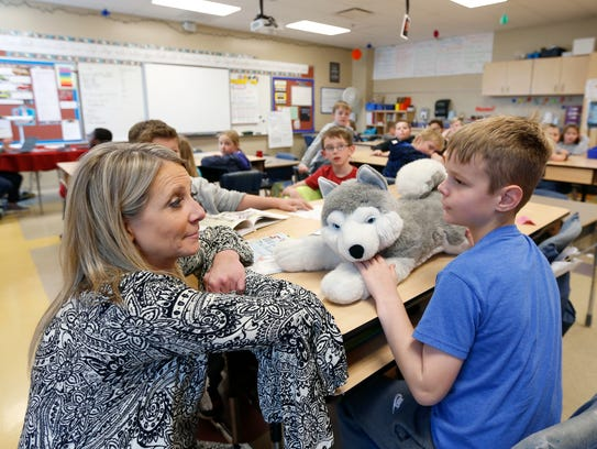 David Harrison Elementary School Principal Chris Parker talks with Everett Franklin, 9, as she drops by classrooms on Tuesday, March 6, 2018.