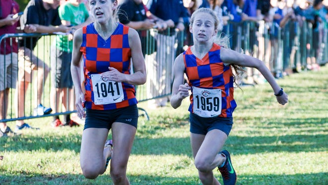 Riverside's Cate Ambrose, left, and Jessie Crowley approach the finish line in Saturday's Eye Opener cross country meet at the Roger Milliken Center in Spartanburg. Crowley edged Ambrose to win the race.