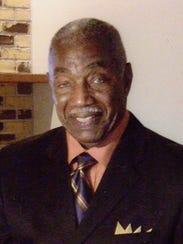 Robert Green, a 1949 graduate of Dunbar High, will