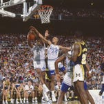 Seton Hall's Ramon Ramos (25) and Daryll Walker (24) go for a rebound during their game against Michigan on April 3, 1989 in Seattle.