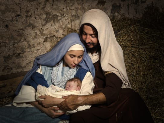 Live Christmas nativity scene in an old barn - Reenactment