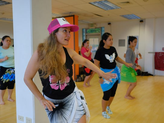 Pinki Lujan, instructor, teaches her students during
