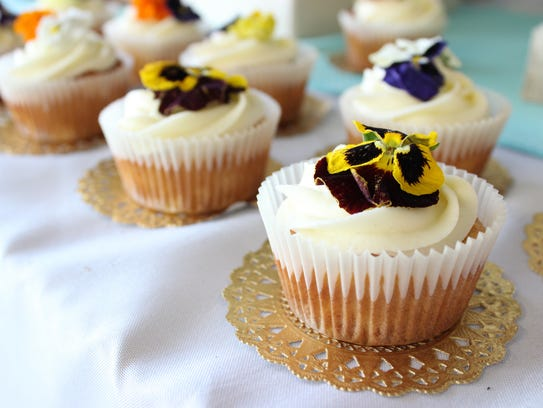 Tropical vanilla cupcakes feature edible pansies.
