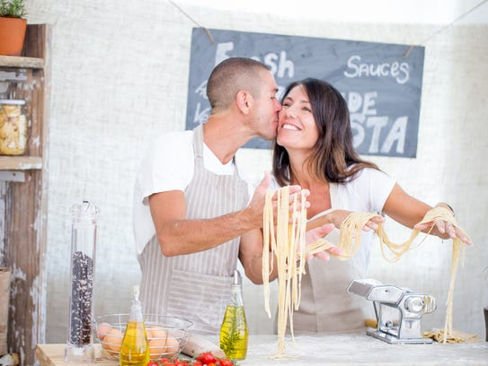 Young couple attending a cooking class where they learn