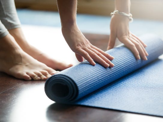 Choose the proper yoga mat.