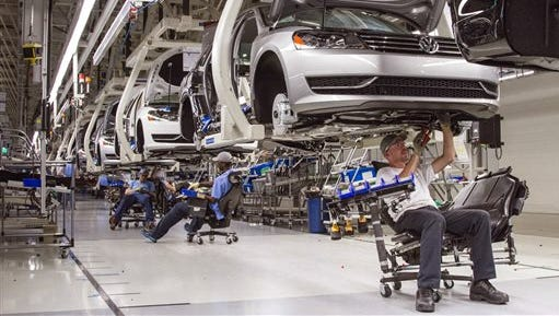 In this July 12, 2013, file photo, employees at the Volkswagen plant in Chattanooga work on the assembly of a Passat sedan. Volkswagen is seeking to add to a planned expansion announced last year to produce a new sport utility vehicle in Tennessee, the Chattanooga Times Free Press reported Sunday.