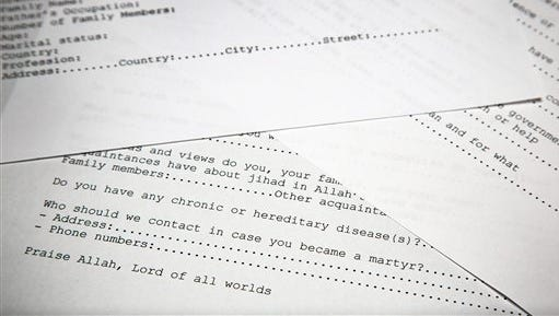 A translated copy of an application to join Osama bin Laden's terrorist network is photographed in Washington, Wednesday, May 20, 2015. The document is among 100 realized by U.S. intelligence officials. U.S. intelligence officials have released more than 100 documents seized in the raid on Osama bin Laden's compound, including a loving letter to his wife and a job application for his terrorist network. The Office of the Director of National Intelligence says the papers were taken in the Navy SEALs raid that killed bin Laden in Pakistan in 2011.(AP Photo)