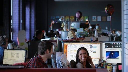 Intern Brach Goodman, 22, of Detroit, left, and Marissa Sayajon, 32, of Warren, at HelloWorld headquarters in Pleasant Ridge, May 6, 2013.