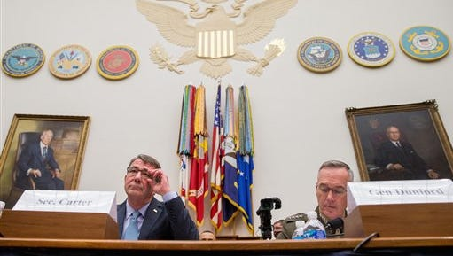 Defense Secretary Ash Carter, left, and Joint Chiefs Chairman Gen. Joseph Dunford Jr., appear on Capitol Hill in Washington, Tuesday, Dec. 1, 2015, before the House Armed Services Committee hearing on the U.S. Strategy for Syria and Iraq and its Implications for the Region.