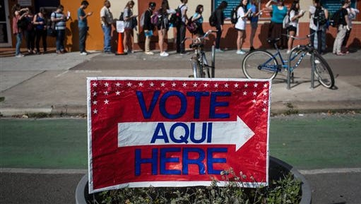 Voters wait in line to cast their Super Tuesday ballots at a polling station located at the University Co-op in Austin, Texas on March 1. Some groups are translating more election material into Spanish.