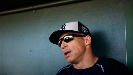 New York Yankees manager Joe Girardi speaks to the media before the start of an exhibition spring training baseball game against the Miami Marlins Tuesday, March 8, 2016, in Jupiter, Fla. (AP Photo/Jeff Roberson)