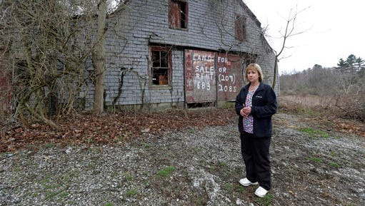 """In this April 12, 2016 photo, Desiree Moninski, stands on land located across from her house in Dudley, Mass., which is the site of a proposed Muslim cemetery, a project vigorously opposed by area residents. Regarding the land once farmed by her grandparents, Moninski said she and other opponents have legitimate concerns that have nothing to do with Islam. """"I grew up here. It's farmland, and I'd like to see it stay that way,"""" she said."""