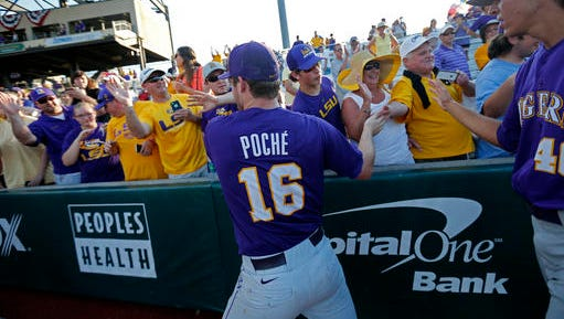 LSU pitcher Jared Poche' (16) celebrates with fans after defeating Rice in an NCAA college baseball tournament regional game in Baton Rouge.