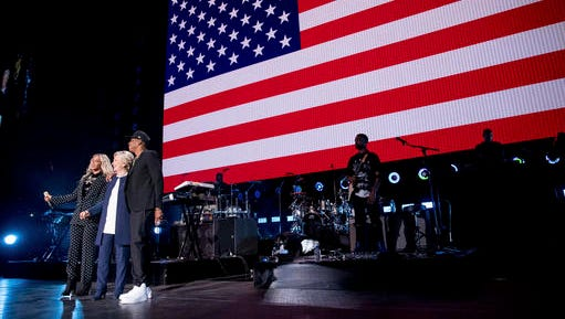 Democratic presidential candidate Hillary Clinton, second from left, appears on stage with artists Jay Z, right, and Beyonce, left, during a free concert at at the Wolstein Center in Cleveland, Friday, Nov. 4, 2016.