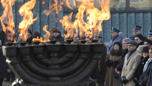 People watch ceremonies marking the Holocaust Remembrance Day, at the Warsaw Ghetto Uprising memorial in Warsaw, Poland, Friday, Jan. 27, 2017.