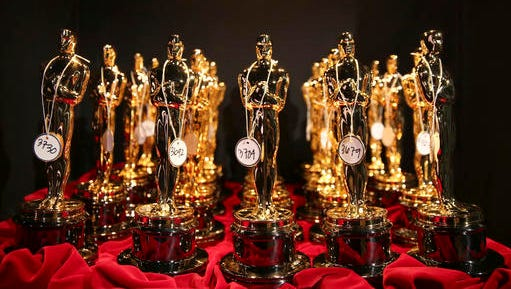FILE - This March 2, 2014 file photo shows Oscar statues lined up backstage during the Oscars in Los Angeles. The 89th Academy Awards will be held on Sunday.