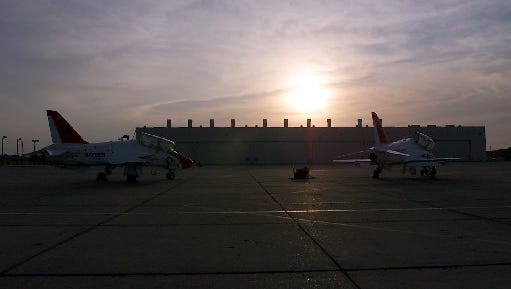 The sun is setting before the flight, at Naval Air Station-Kingsville.